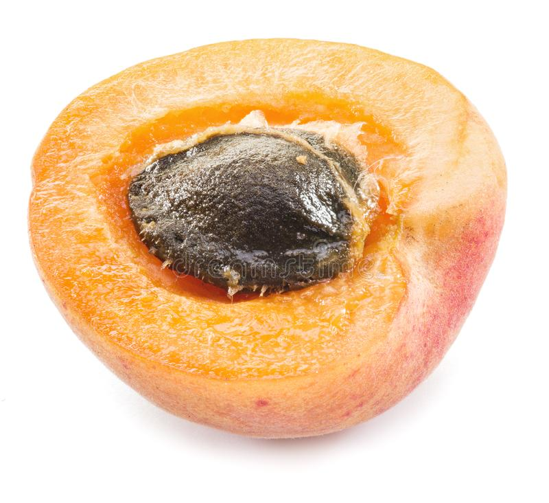 Juicy apricot`s cross-section on the white background. royalty free stock image