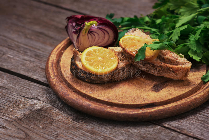 Juicy baked salmon with lemon and herbs royalty free stock images