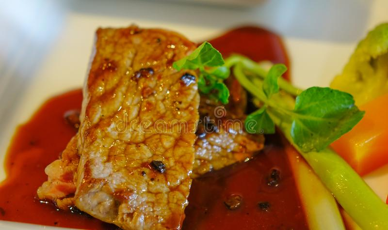 Juicy beef pepper steak with red berry sauce royalty free stock photos