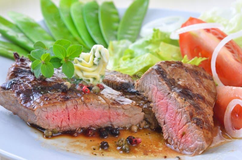 Juicy beefsteak stock photos