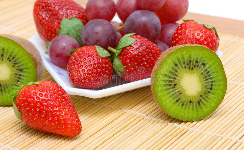 Download Juicy Berries And Fruit - Kiwi, Strawberries And Grapes. Stock Image - Image: 28787811