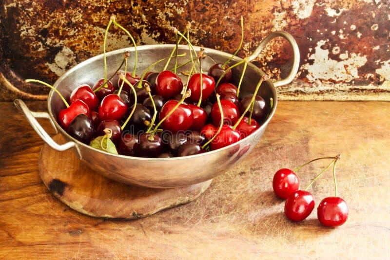 Juicy cherries in bowl on table royalty free stock image