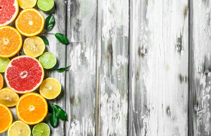 Juicy citrus with leaves. On wooden background stock photos