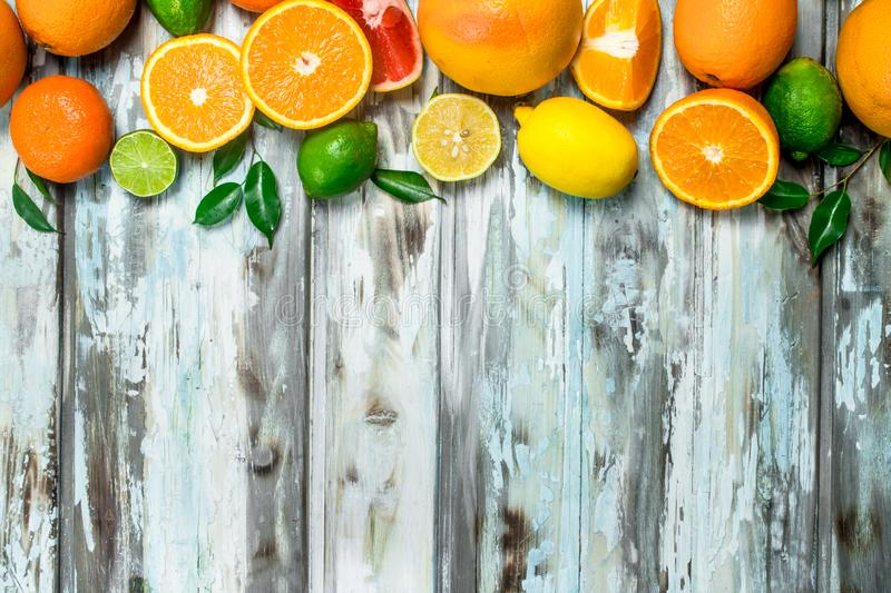 Juicy citrus with leaves. On wooden background royalty free stock image