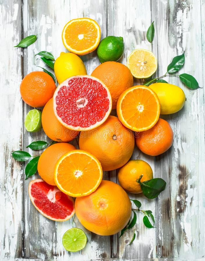 Juicy citrus with leaves. On wooden background royalty free stock images