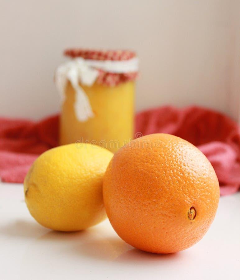 Juicy citrus and lemon jam. Juicy citrus, orange, lemon and lemon jam near the window stock photos