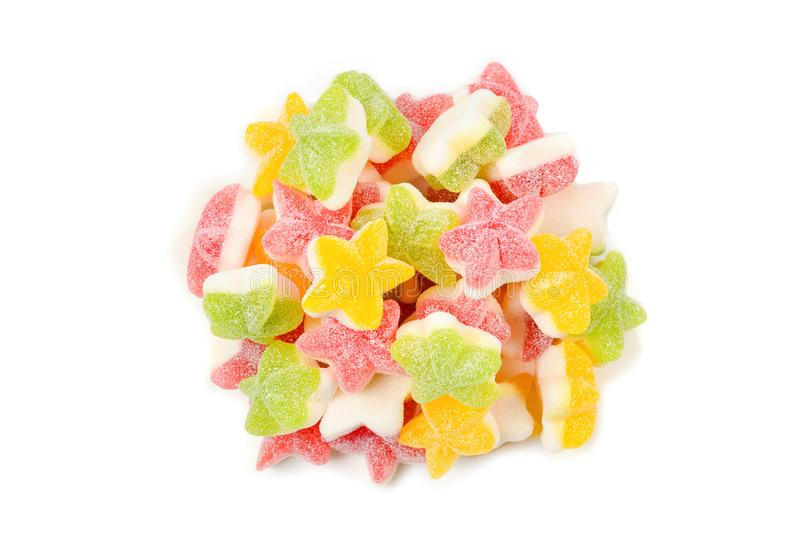 Juicy colorful jelly  stars sweets isolated on white. Gummy candies royalty free stock image