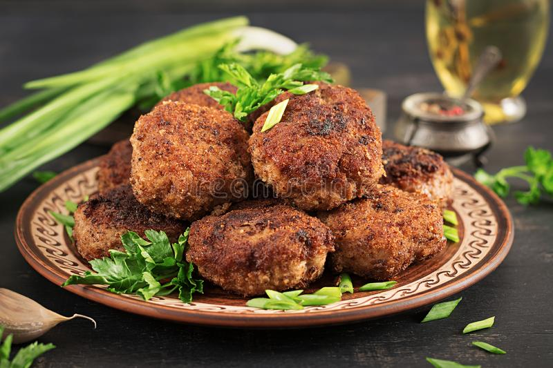 Juicy delicious meat cutlets on a dark table. Russian cuisine royalty free stock photography