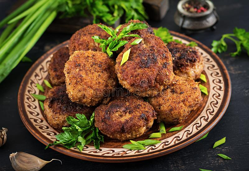 Juicy delicious meat cutlets on a dark table. Russian cuisine royalty free stock photos
