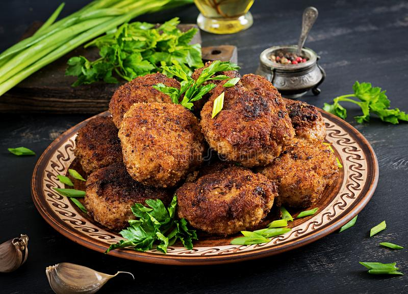 Juicy delicious meat cutlets on a dark table. Russian cuisine stock photography