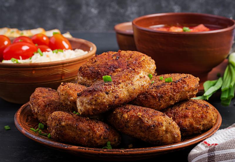 Juicy delicious meat cutlets on a dark table. Russian cuisineJuicy delicious meat cutlets on a dark table. Juicy delicious meat cutlets on a dark table. Russian royalty free stock images