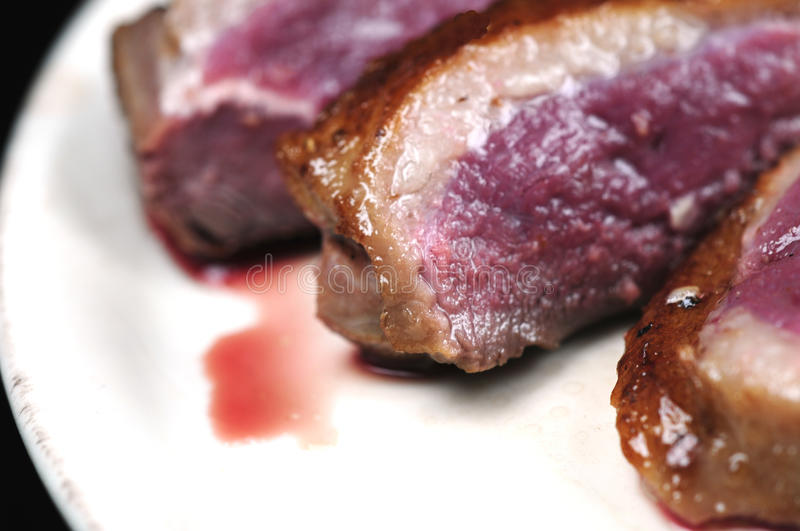 Juicy duck breast. On a plate royalty free stock photo