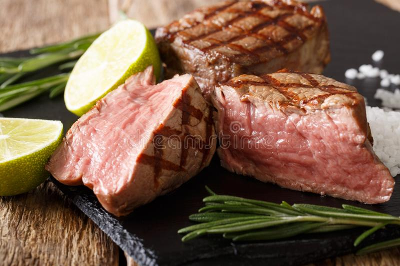 Juicy fillet mignon beef steak close-up on a cutting board. horizontal stock image