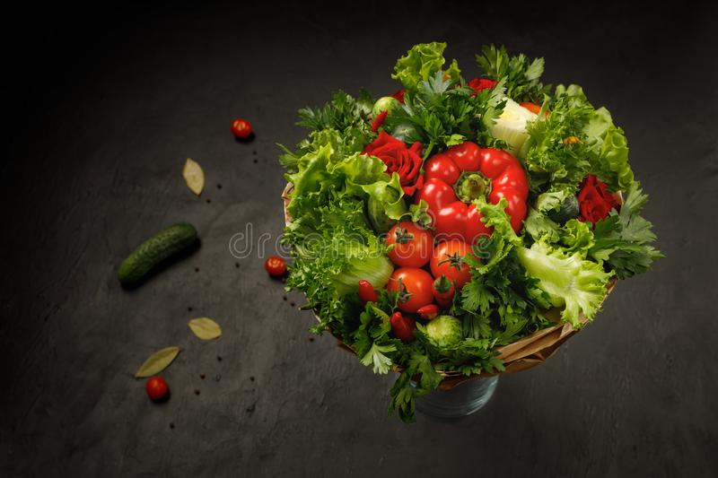 Juicy, fresh and colorful edible bouquet of vegetables on a black background royalty free stock photography
