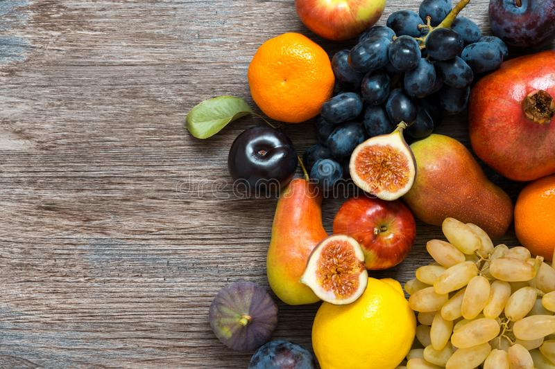 Juicy fresh fruit on a wooden dark table, top view. stock photo
