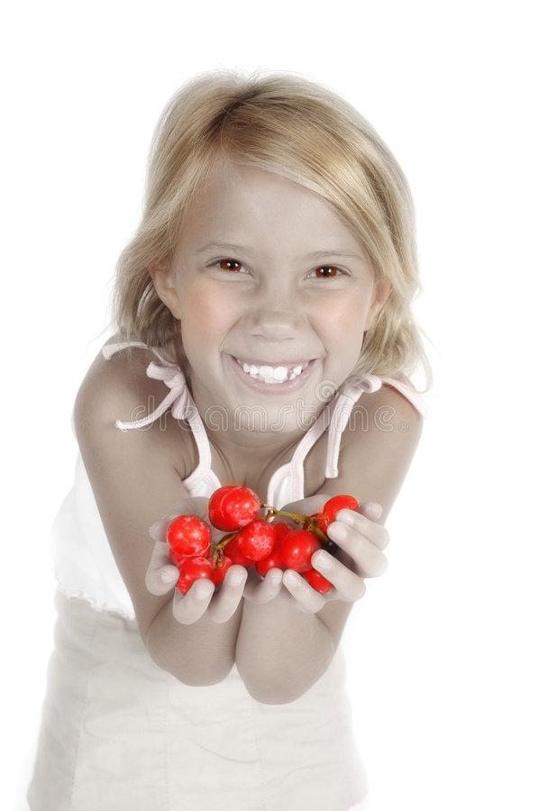 Juicy Fruit. Black and white, slightly handtinted image. Little girl holds out hand to tempt you to eat grapes. Little child hods out healthy food choice stock photography