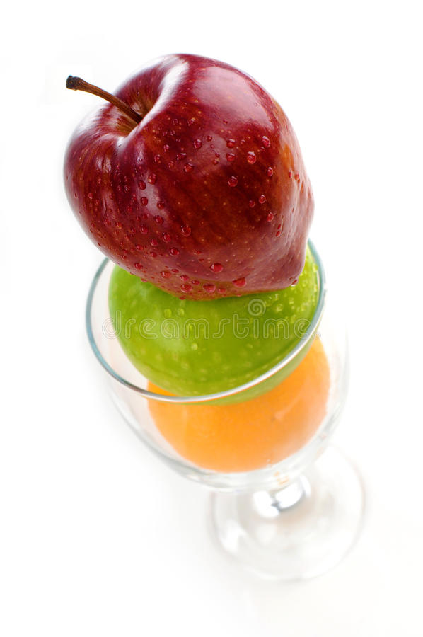 Juicy fruits in wine glass. Isolated white background stock photography