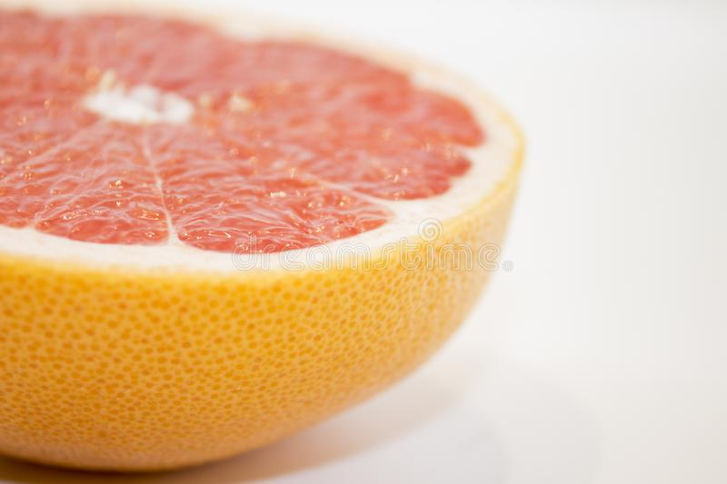 Juicy grapefruit close up view on white background royalty free stock photos