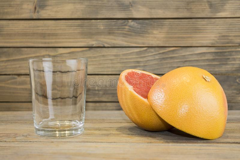 Juicy grapefruit close up view on wooden background royalty free stock photos