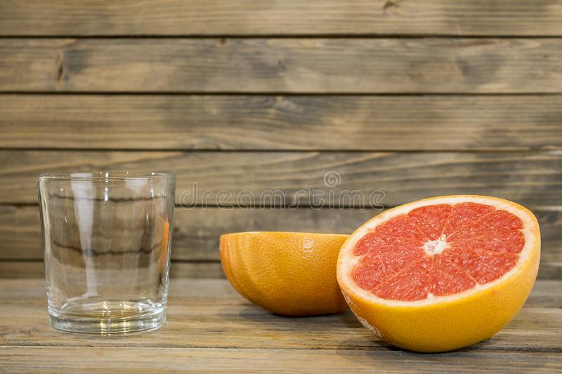 Juicy grapefruit close up view on wooden background royalty free stock images