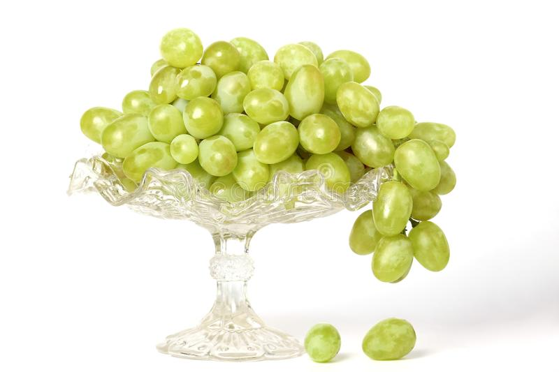 Juicy green grapes in a beautiful plate royalty free stock images