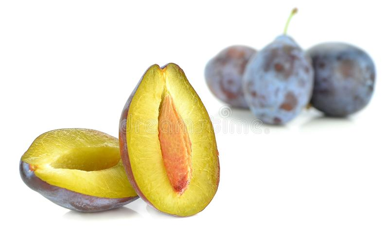 A juicy halved plum. On a white background royalty free stock photography