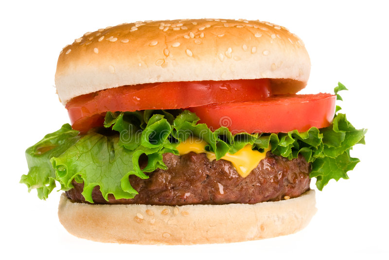 Juicy hamburger. A thick, fresh and juicy hamburger with all the trimmings isolated on white royalty free stock photo