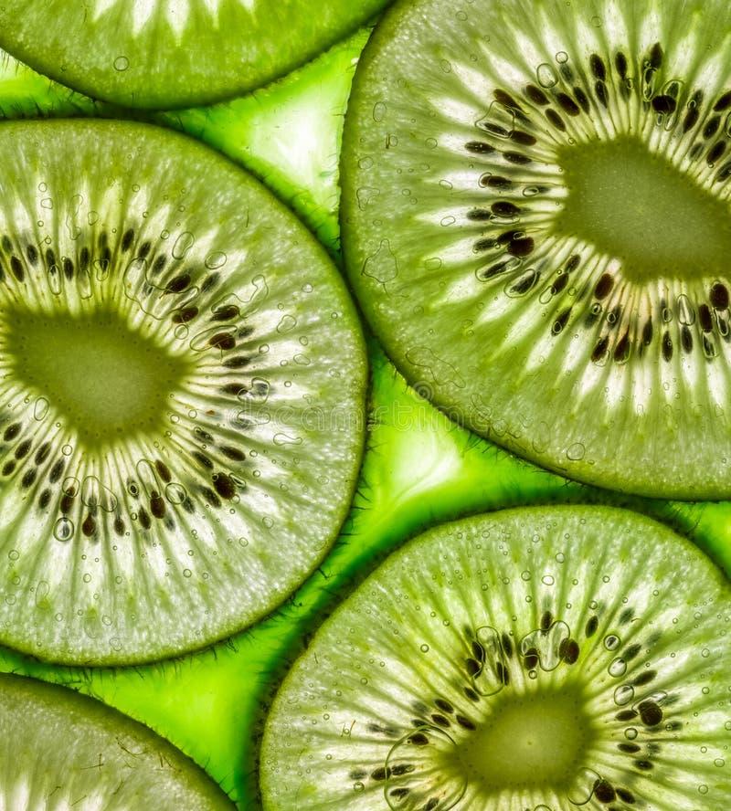 Juicy kiwi slices. Close-up view of juicy kiwi slices stock images