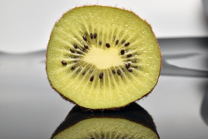 Fresh kiwi on white background stock photos