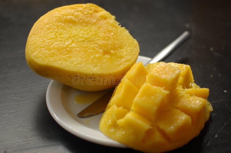 Juicy mango on plate stock photo