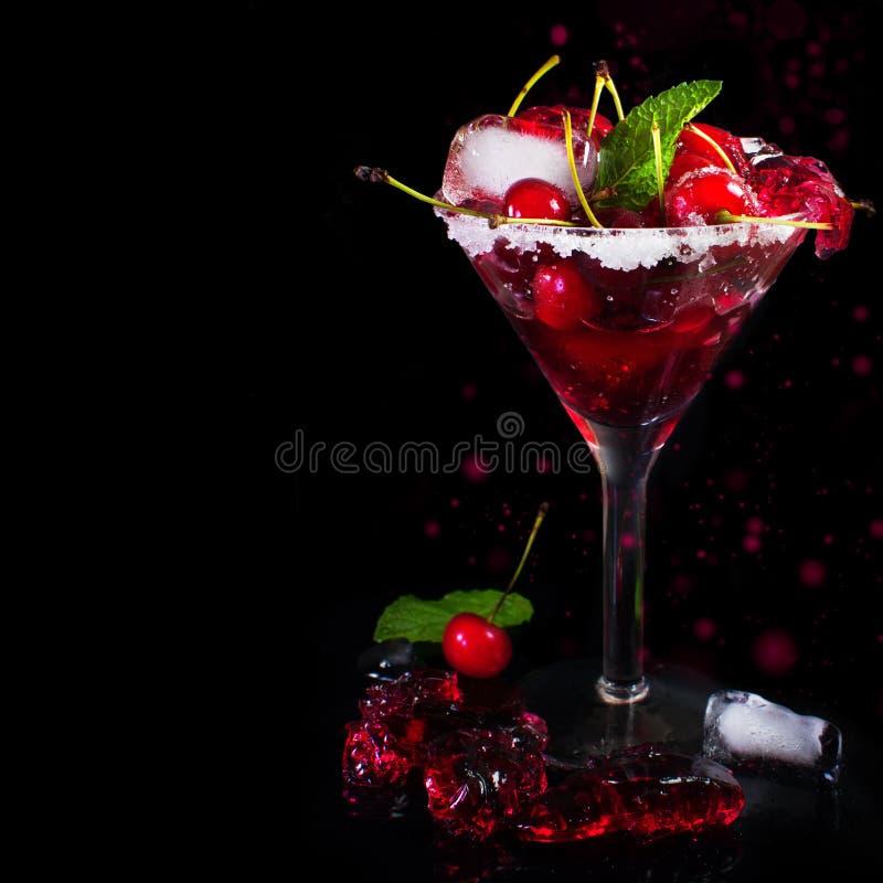 Juicy maraschino cherry on a black background. royalty free stock photo