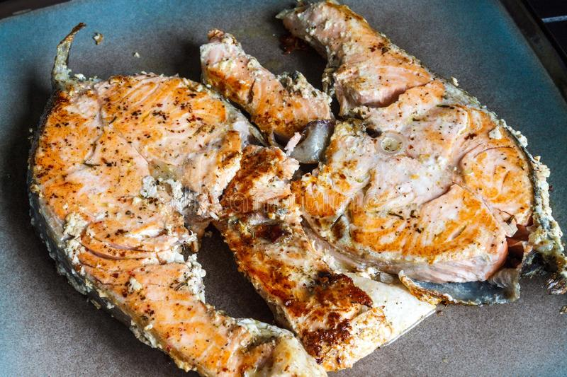 Juicy, mouth-watering fish steak on the plate. Juicy, fish steak on the plate royalty free stock photography