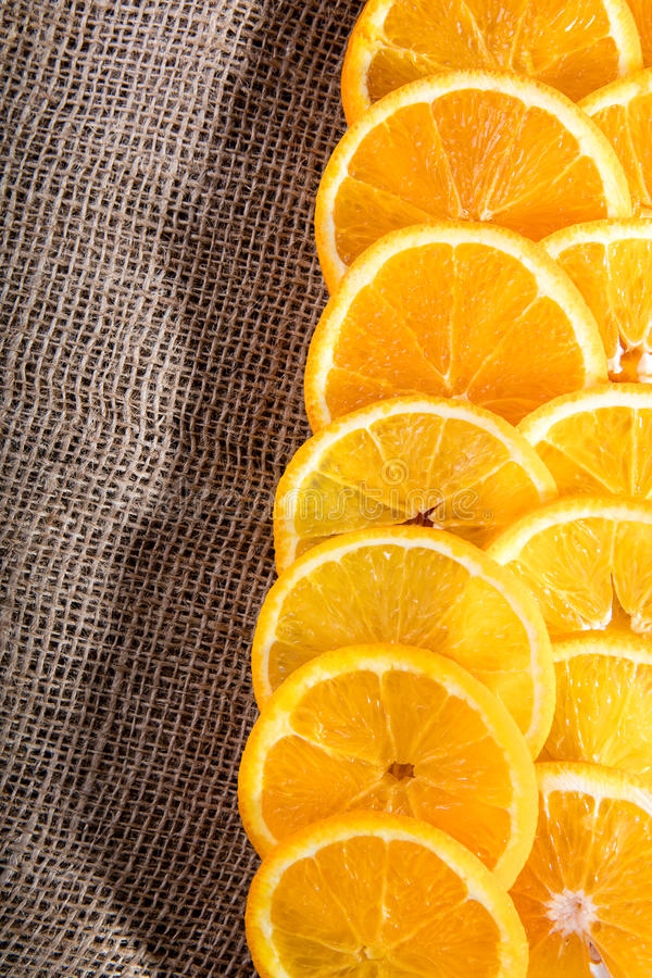 Juicy orange slices on jute bag royalty free stock images