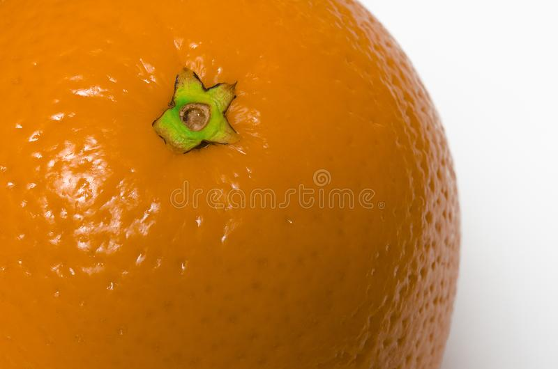 Juicy orange with textured skin closeup lies on a white background stock images