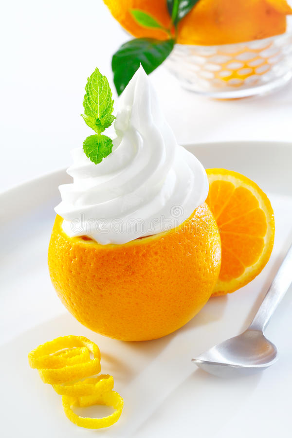 Download Juicy Orange Topped With Softserve Stock Image - Image: 25734295