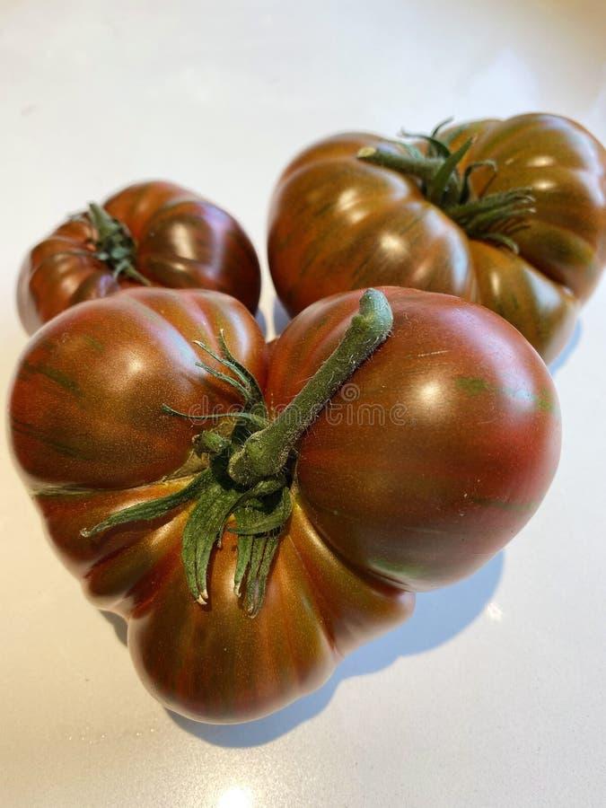 Juicy Organic Heirloom Tomatoes stock image