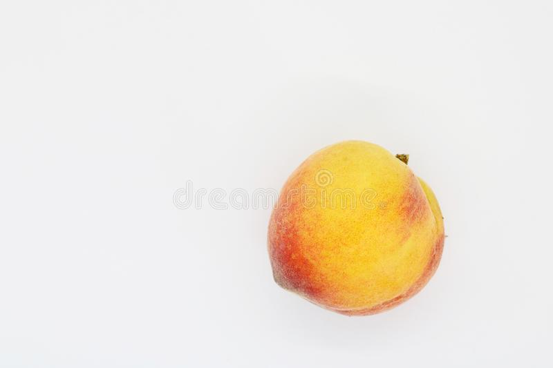 Juicy peach closeup on white background. royalty free stock image