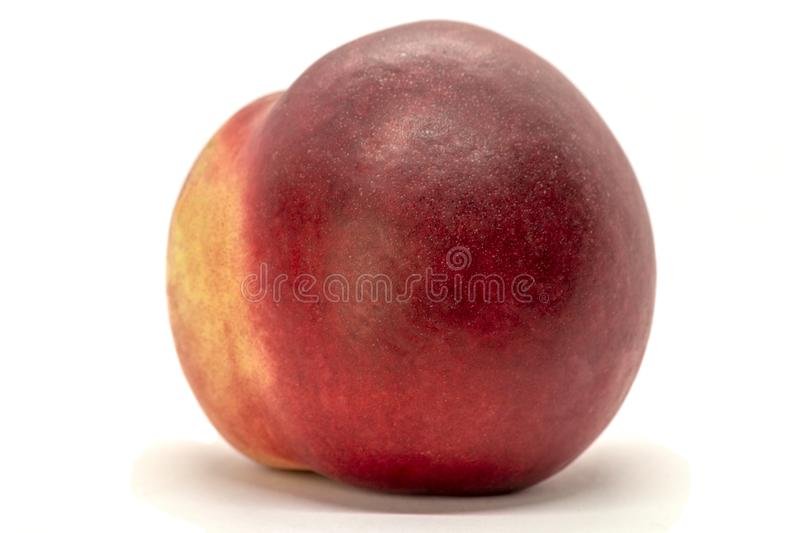 Juicy peach-nectarine isolated on white background. Tasty and sweet. Red, yellow royalty free stock photos