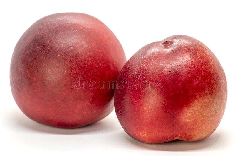 Juicy peach-nectarine isolated on white background. Tasty and sweet. Red, yellow stock photos