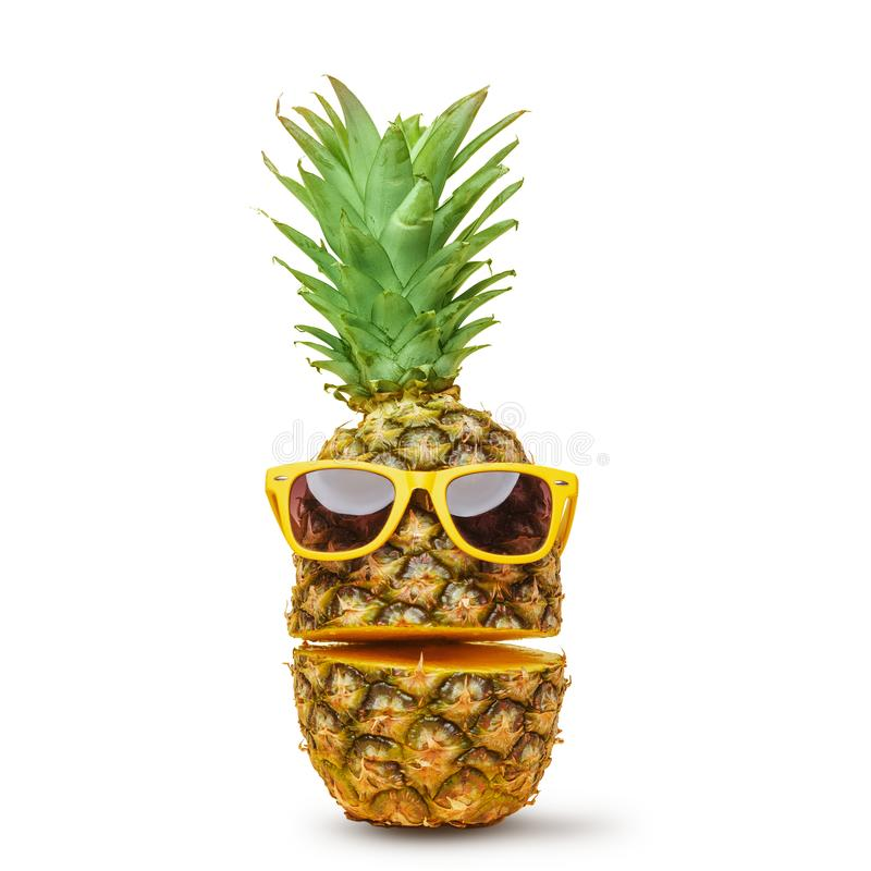 Juicy pineapple in sunglasses, cut into parts on a white background. Summer mood. Isolated royalty free stock image