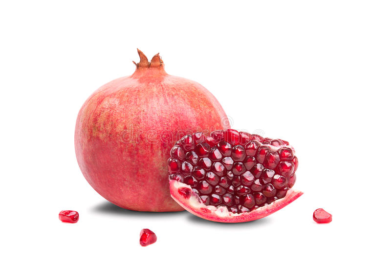 Juicy pomegranate fruit lies on a white background royalty free stock image