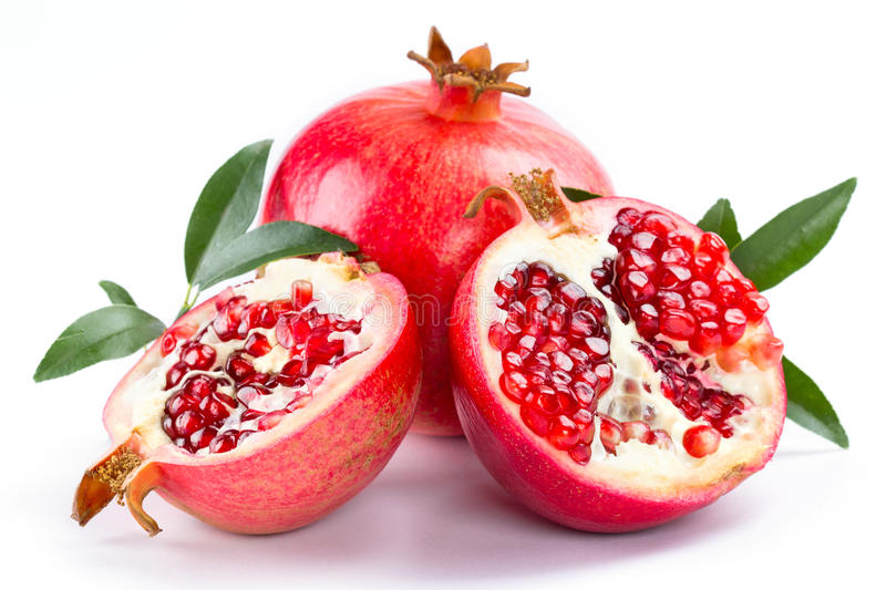 Juicy pomegranate and its half with leaves stock photo