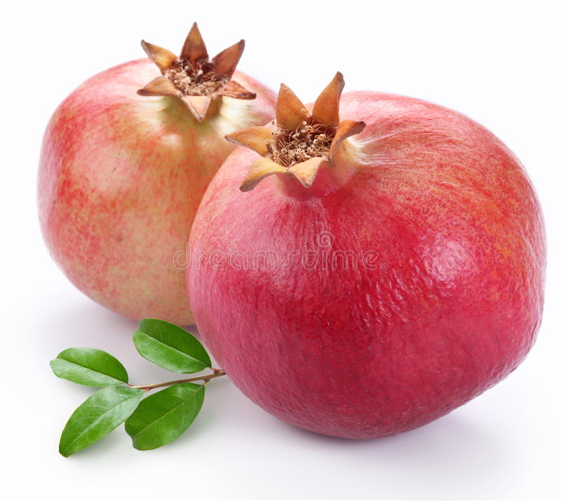 Juicy pomegranates with leaves. stock image
