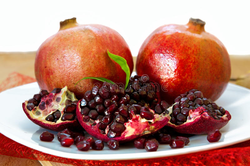 Juicy pomegranates on wood. royalty free stock photo