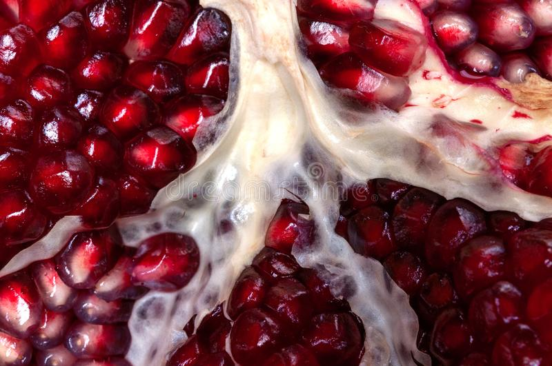 Juicy pomegranates on wood season specifick stock photography