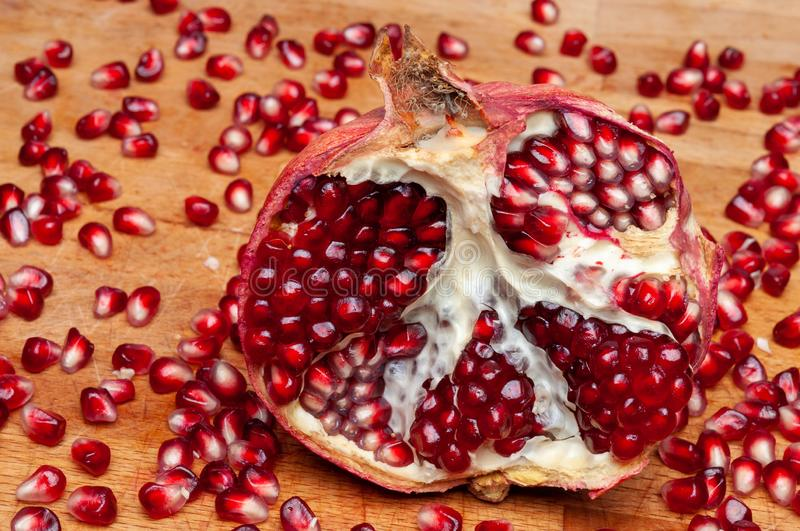 Juicy pomegranates on wood season specifick royalty free stock images