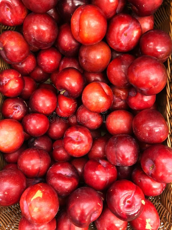 Juicy red tasty plum on the market. View royalty free stock image