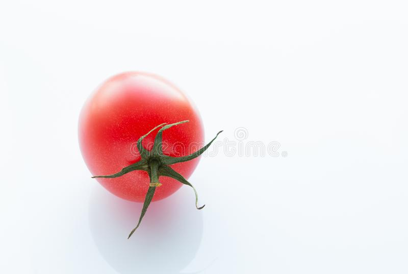 Juicy red tomato on a white background, close-up stock photo