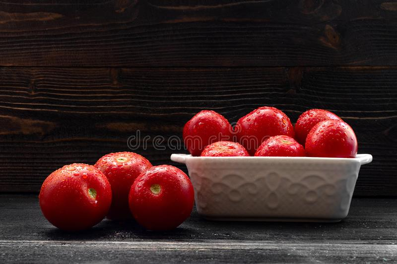 Juicy Red Tomatoes still life. On dark background stock image