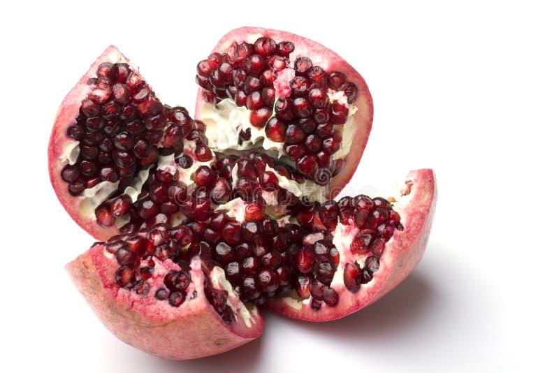 Juicy ripe fresh pomegranate fruit cut opened stock photo